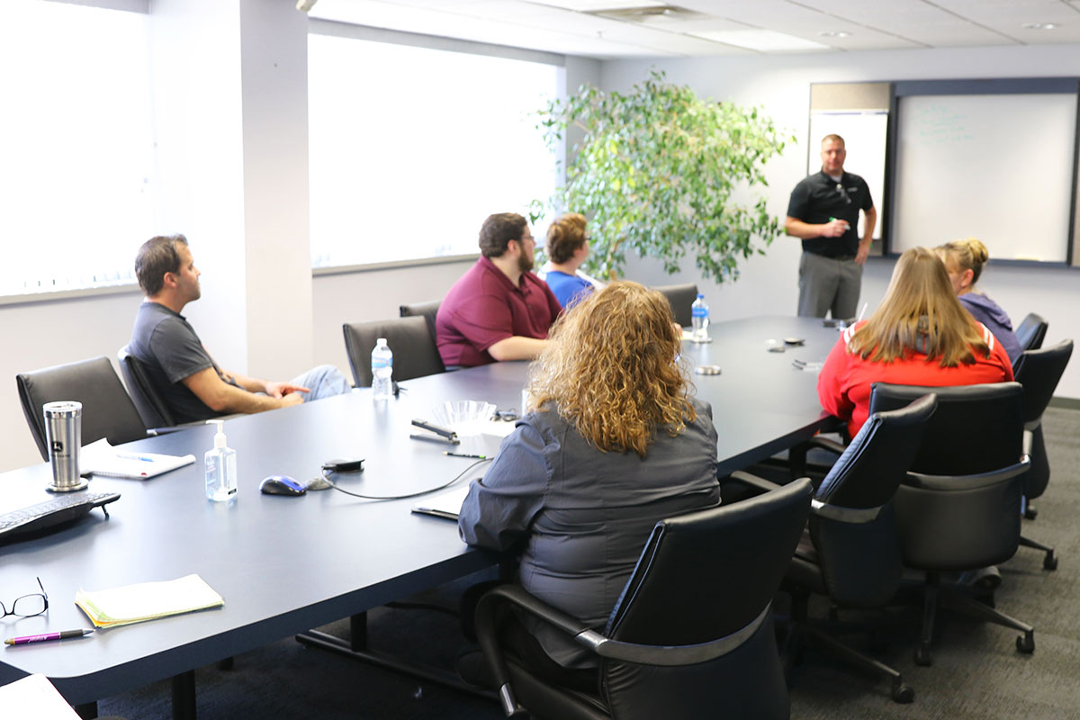 Kaysun employees meeting in a conference room