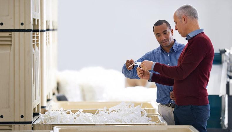 workers debating plastic part design